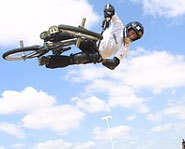Picture of Dave Mirra launching a big air on his BMX bike during the X Games.
