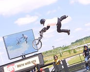 Photo of Dave Mirra doing a BMX trick on his bike at the X Games.