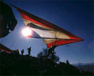 Picture of a hang glider as he takes to the skies.