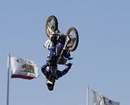 Photo of Nate Adams turning a backflip at X Games X.