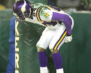 Randy Moss mimics a moon at Lambeau Field.
