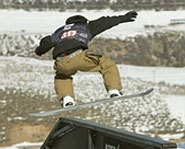 Shaun White rides a rail in the Snowboarding Slopestyle event at the Winter X Games.
