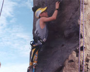 Athlete rock climbs using prosthetic legs.