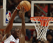 Picture of Dwyane Wade going for a dunk.