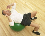 Crunches using an exercise ball can be a great ab workout.