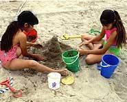 Building sand castles is great fun on the first day of summer.