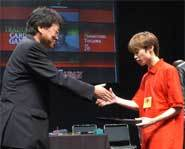 2004 Yu-Gi-Oh! King of Games accepts the trophy for winning the world championship Yu-Gi-Oh! tournament!