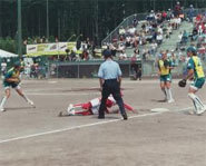 A umpire makes a call during a game of softball.
