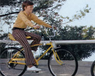Picture of cyclist riding a new bicycle.