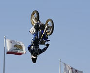 Picture of freestyle motocross rider Nate Adams doing tricks at the 2004 X Games.