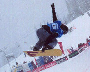 Picture of snowboarder riding the Halfpipe at Snowboarding World Cup event in Whistler, Canada.