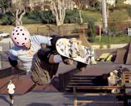 Skateboarder Cara Beth Burnside rides a vert ramp while wearing a Barbie Helmet.