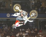 Motorcross master Carey Hart did a backflip on his motorcycle at the 2002 X Games.