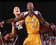 Lisa Leslie of the WNBA's Los Angeles Sparks is leading her team to a second straight WNBA title.