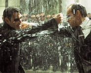 Agent Smith, played by Hugo Weaving battles with Neo, played by Keanu Reeves, in The Matrix Revolutions.