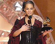 Alicia Keys wins 5 Grammy Awards.