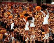 Picture of cheerleaders performing a routine at a game.