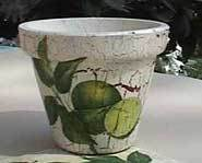 You can make your own decoupage flower pot for Mom.