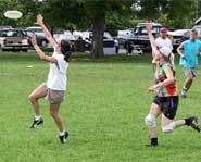 Picture of guy playing Ultimate Frisbee on a field.