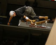 Bucky Lasek lauches off the vert ramp on his skateboard at the X Games.