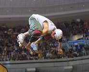 Bucky Lasek hits some big air in the vert ramp at the X Games.