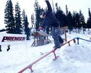 Riding a rail on a JP Walker Snowskate
