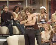 Kelly Clarkson and Justin Guarini share a hug after a performance on American Idol.