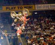 Picture of Carey Hart doing a back flip.