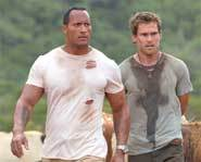 The Rock stars in the action movie, The Rundown, with Seann William Scott and Rosario Dawson.