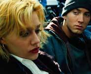 Brittany Murphy teams up with Eminem in the flick 8 Mile.