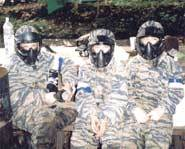 Paintball equipment includes goggles, facemask and camouflage clothing.