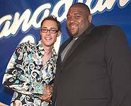 The first Canadian Idol Ryan Malcolm stands with American Idol Ruben Studdard.