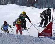 Aleisha Cline flies over a jump in the Skier X at the 2004 Winter X Games.