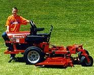Ryan with one of his many donated lawnmowers.