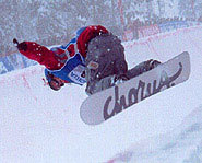 A snowboarder rides through a halfpipe during a World Cup Snowboarding event.