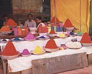 Local merchants sell powdered paint for Holi celebrations.