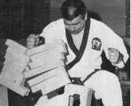 Breaking boards in martial arts takes professional training, proper set up and strong hands.