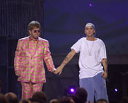 Awe - Em and Elton holding hands.