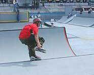 Inline skating in a half pipe.