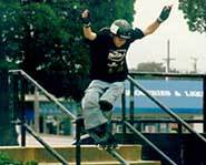 Riding a rail - inline skating style.