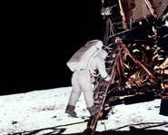 Buzz Aldrin climbs down and onto the Moon. Shouldn't the shadow make him completely in darkness?
