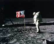 Neil Armstrong, the first man on the moon puts up an American flag.