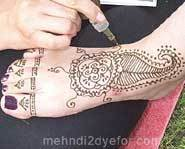 A foot being hennaed.