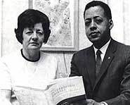 Betty and Barney Hill with a book they wrote about the abduction.