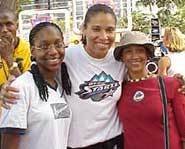 Natalie Williams and two fans at the WNBA All-Star Summer Jam.