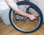 Give the glue about three minutes to dry on the tire.
