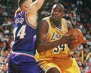 Shaq tires to draw a foul