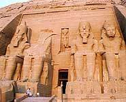 Ramesses II on his own temple, alongside one of his many wives.