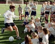 Mia Hamm teaching at soccer camp.