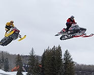 DJ Eckstrom and Blaire Morgan get big air in the Snocross at the Winter X Games